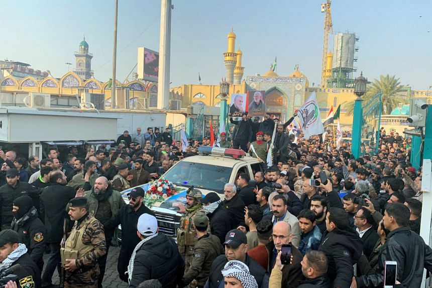 Mourners surround a car carrying the coffin of Iranian military commander Qasem Soleimani in Baghdad on Jan 4, 2020.