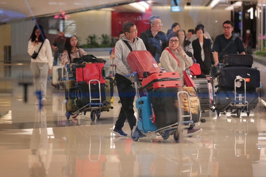 A photo taken on Jan 3, 2020, shows travellers arriving at Changi Airport Terminal 1.