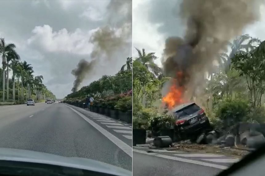 A video from a dashboard camera circulating online shows a car lodged in the shrubbery along the divider, with black smoke billowing from it.
