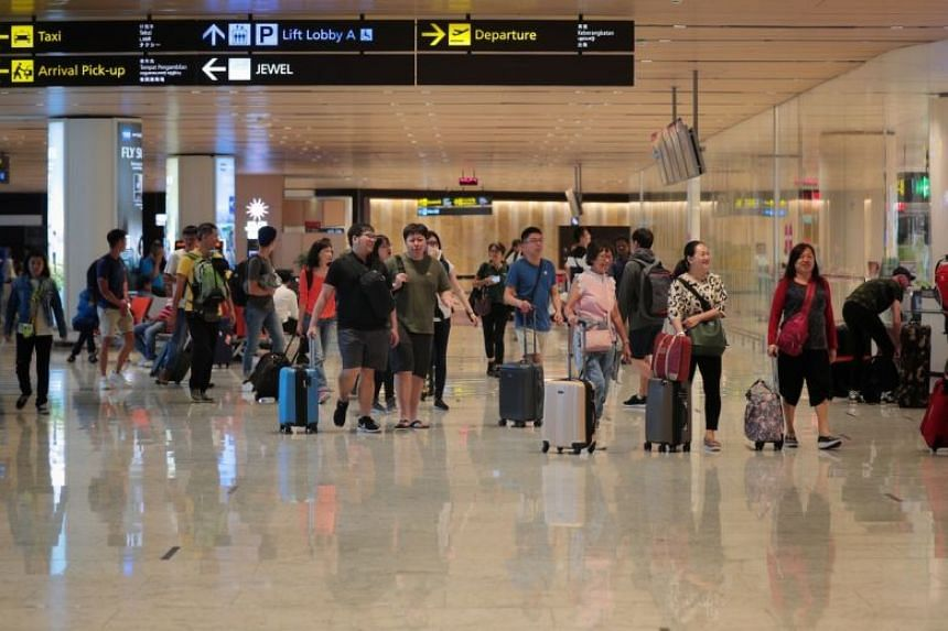 Travellers at Changi Airport terminal one arrival hall on Jan 3, 2020.