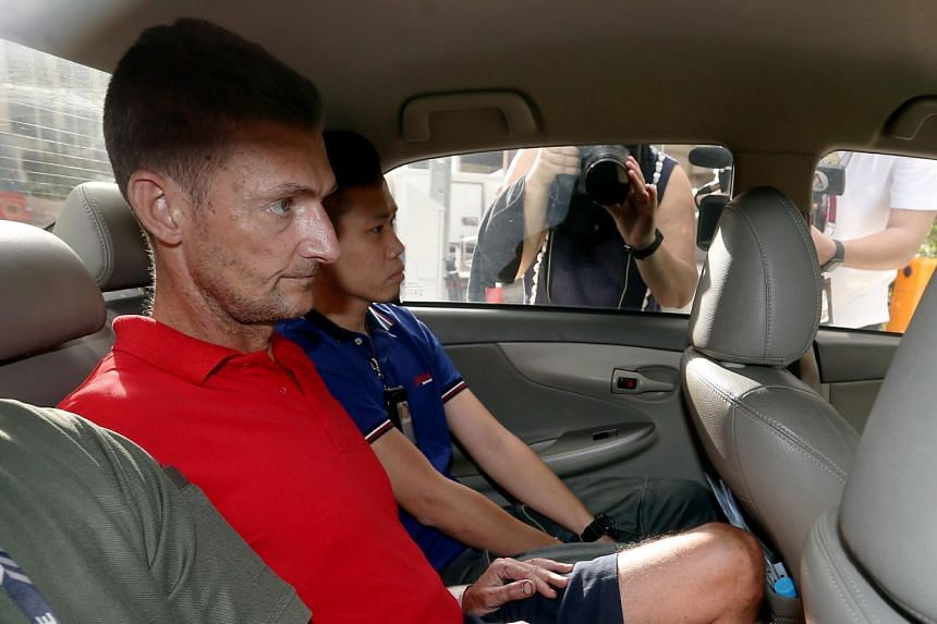 Paul Leslie Quirk (in red) was charged with the murder of Ms Christina Khoo Gek Hwa at Esparina Residences condominium.