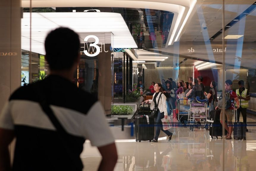 Travellers arriving at Changi Airport terminal one arrival hall on Jan 3, 2020.