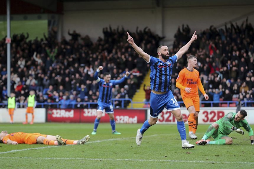 Rochdale's Aaron Wilbraham celebrates after scoring during the English FA Cup match against Newcastle United.