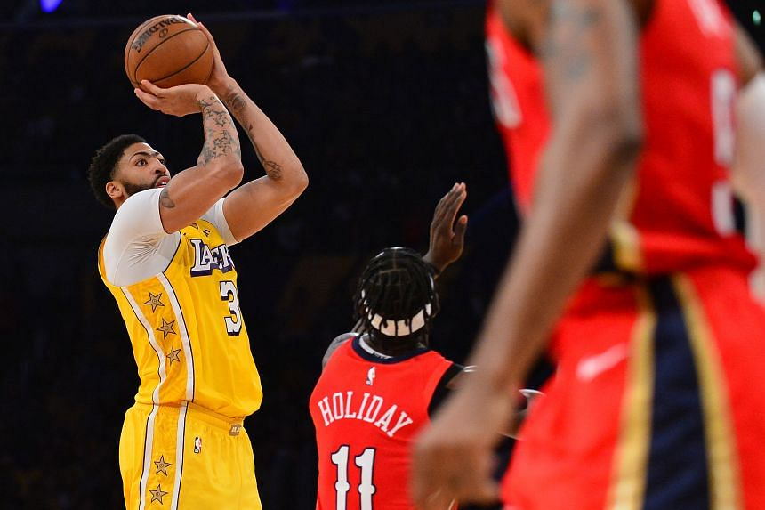 The Los Angeles Lakers' Anthony Davis attempts a shot during the NBA game against the New Orleans Pelicans.