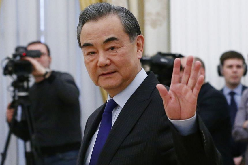Chinese Foreign Minister Wang Yi said during a call with his Iranian counterpart that the US seek solutions through dialogue.