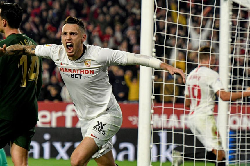 Sevilla's Lucas Ocampos celebrates an own goal during the La Liga match against Athletic Bilbao.