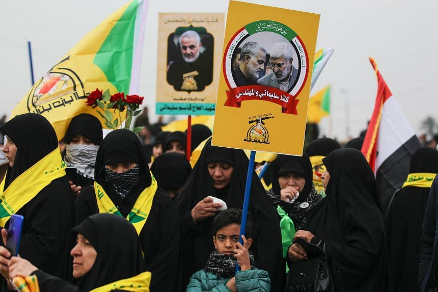 Supporters of the Hashed al-Shaabi paramilitary force and Iraq's Hezbollah brigades attend the funeral of Iranian military commander Qasem Soleimani and Iraqi paramilitary chief Abu Mahdi al-Muhandis in Baghdad' on Jan 4, 2020.