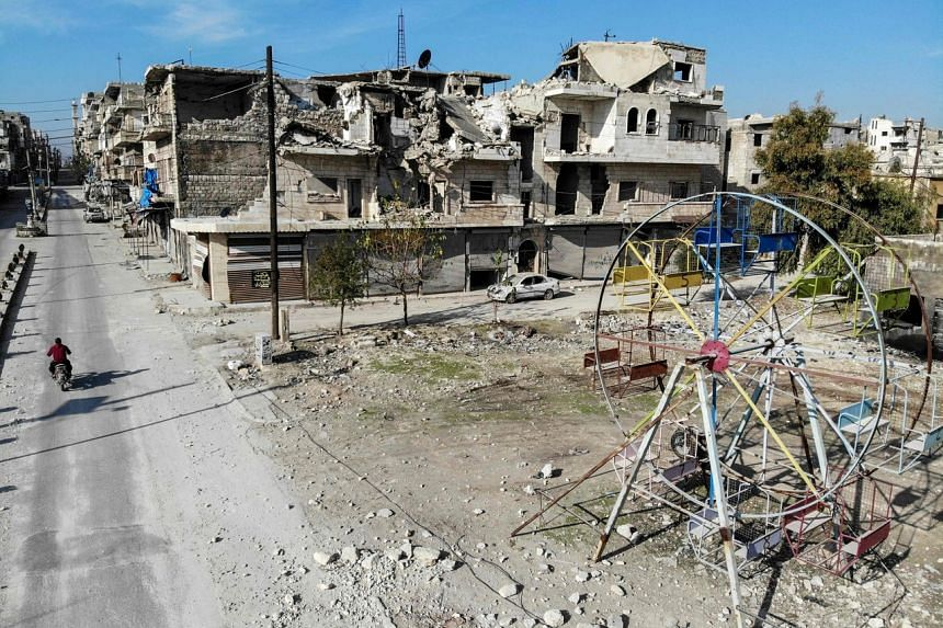 A photo taken on Dec 22, 2019, shows a deserted playground and damaged buildings in the town of Maaret Al-Numan, in Syria's northwestern Idlib province.
