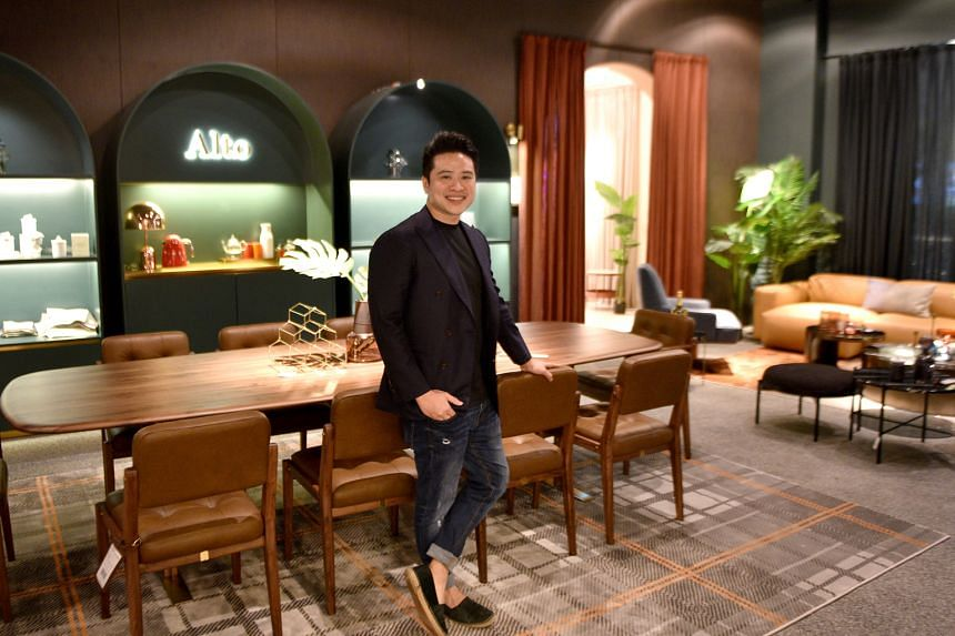 Mr Julian Koh with a 10-seater dining table at Alto - an extension of the Commune store - at Millenia Walk. Besides bigger pieces, Alto's collections also feature higher-grade materials and bolder designs.