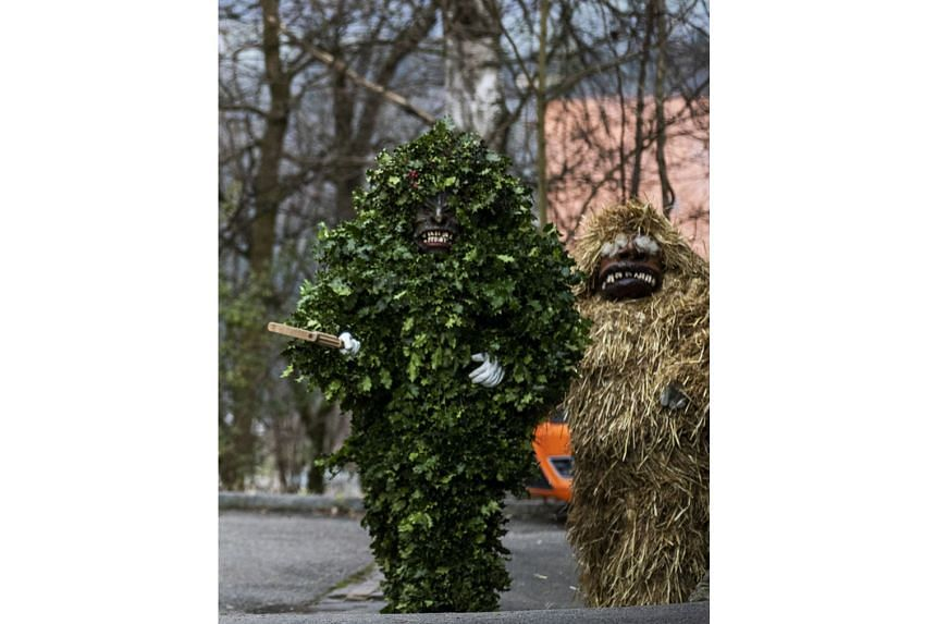 These figures might look threatening, but those who hug them are supposed to be blessed with good luck for the new year. As part of the old tradition known as Baerzeli, observed every year on Jan 2, 15 young men are transformed into traditional Baerz