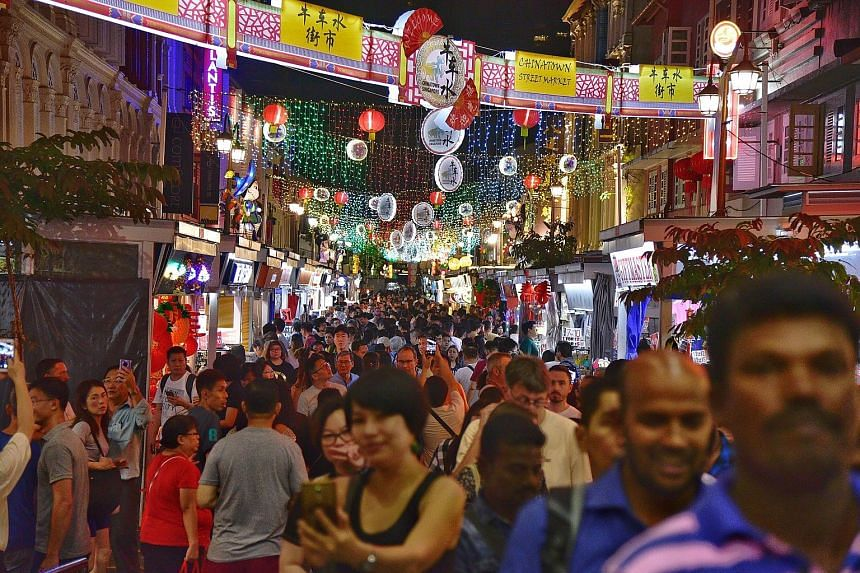 Crowds at the Chinatown night bazaar yesterday. The light-up, which ends on Feb 22, is part of the Chinatown Chinese New Year Celebrations organised by Kreta Ayer-Kim Seng Citizens' Consultative Committee and supported by the Singapore Tourism Board.