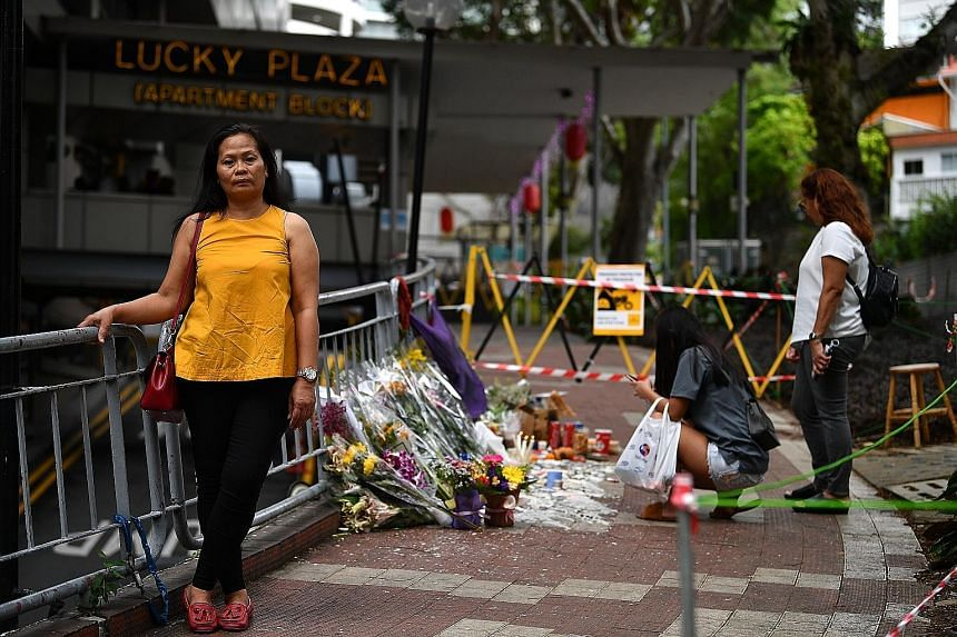 Top: A 2013 photo showing maids at a walkway between Lucky Plaza and Tong Building in Orchard Road. Above: Filipino maid Leonila Incillo near the site of the accident at Lucky Plaza where people have placed flowers in memory of the victims. Madam Inc