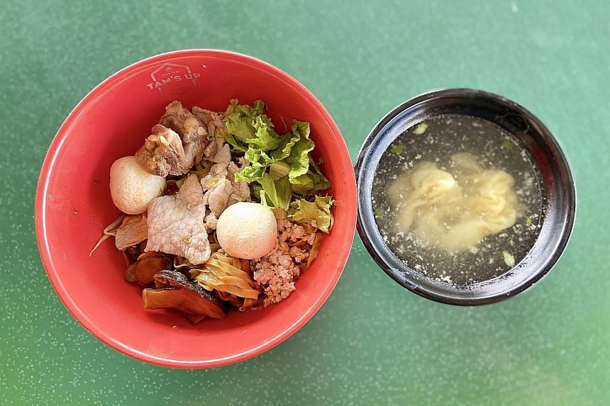 The signature noodles at Tam's Up are fishball noodles, bak chor mee and wonton mee in one delightful mix.