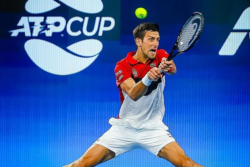 Serbian world No. 2 Novak Djokovic returning to Kevin Anderson of South Africa at the ATP Cup in Brisbane. He was made to work hard, taking both sets on tiebreaks to clinch victory for his team. PHOTO: AGENCE FRANCE-PRESSE
