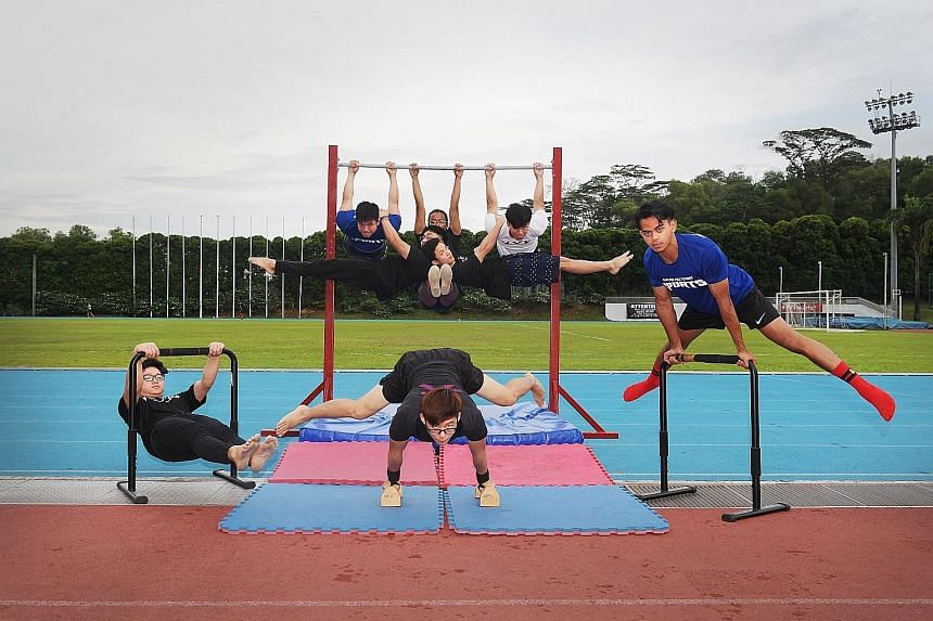 Members of the Nanyang Polytechnic Street Workout club demonstrating some of their moves as they look to make callisthenics fun and appealing. ST PHOTOS: ALPHONSUS CHERN Suzannah Chia, 17, one of three women in the club, performing the elbow lever, a