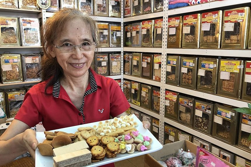 Madam Shen Limin is happy her biscuits remind customers of their childhood.