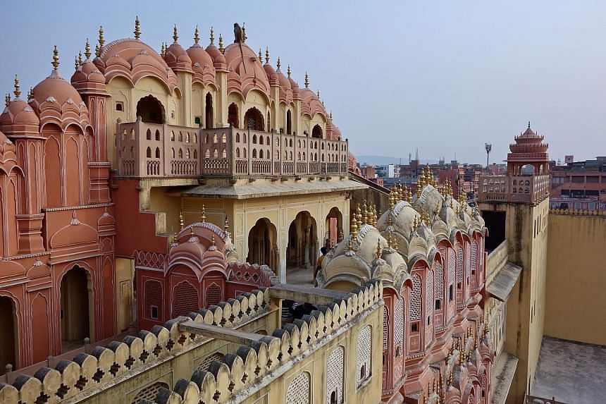 A monkey sitting atop the Hawa Mahal (above), or Palace of Winds, which was previously used by royal ladies to watch processions on the street. The Gudliya Suite (left) in the City Palace is open for bookings via home-sharing site Airbnb. The Bapu Ba