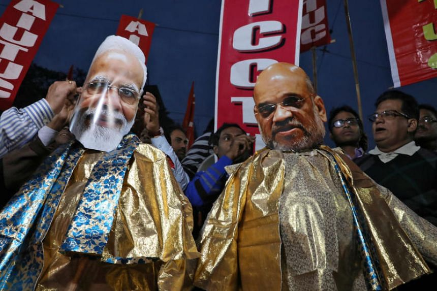 In a photo taken on Jan 2, 2020, demonstrators prepare effigies depicting India's Prime Minister Narendra Modi and Home Minister Amit Shah during a protest rally against a new citizenship law, in Kolkata, India.