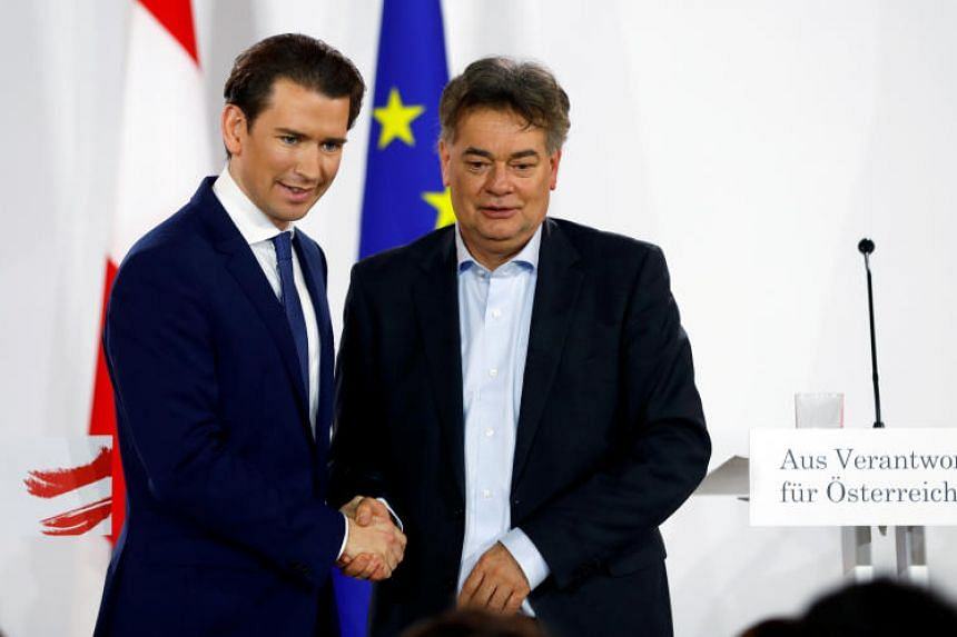 Austria's Green party leader Werner Kogler (right) had urged delegates to put aside concerns about entering into a coalition with Sebastian Kurz's conservatives.