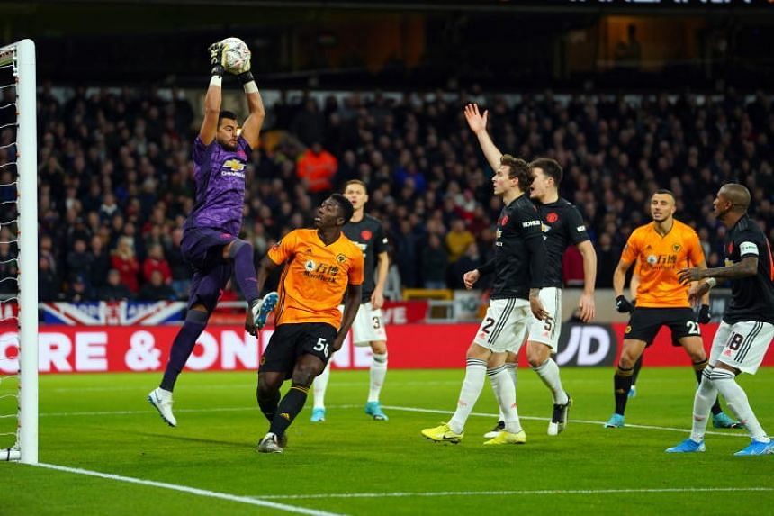 Manchester United's Sergio Romero catches under pressure during the English FA Cup football match against Wolverhampton Wanderers on Jan 4, 2020.