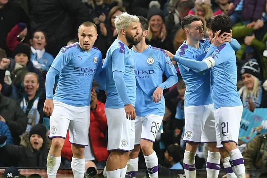 Manchester City's English midfielder Phil Foden (second right) celebrates with teammates after scoring their fourth goal during the English FA Cup third round football match against Port Vale on Jan 4, 2020.