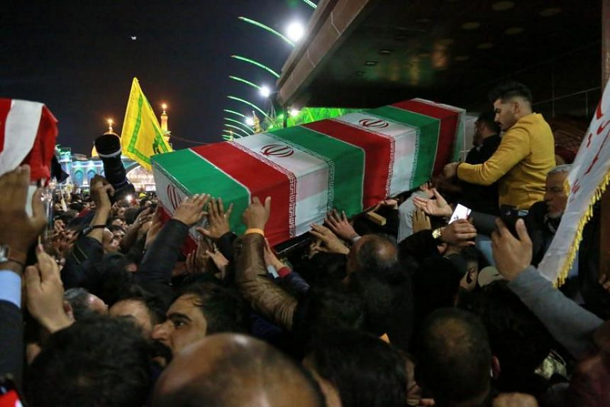 Mourners carry the coffin of Iran's top general Qassem Soleimani during his funeral in Karbala, Iraq, on Jan 4, 2020.