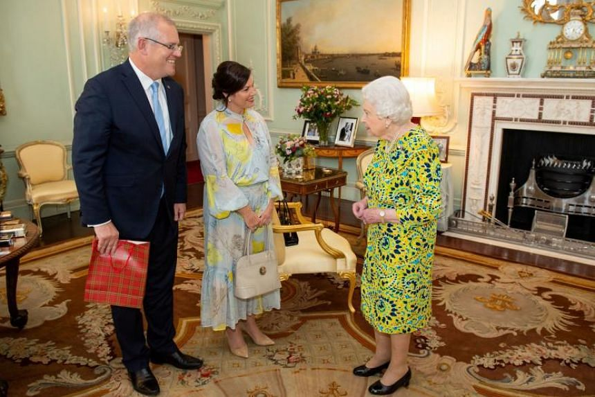 In a file photo taken on June 4, 2019, Queen Elizabeth II meets Australian Prime Minister Scott Morrison and his wife Jennifer during a private audience at Buckingham Palace, in London.