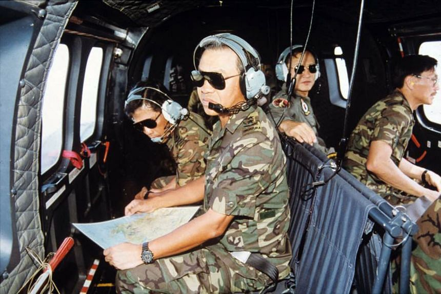Lt-Gen (Ret) Ng (in front) on board a Super Puma helicopter in 1993 to observe Exercise Wallaby at the Shoalwater Bay Training Area in Australia.