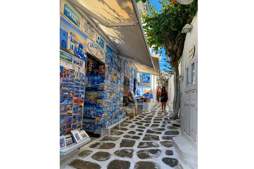Mykonos' shops line narrow lanes and sell everything from trinkets adorned with the iconic Greek evil eye to handcrafted leather sandals.