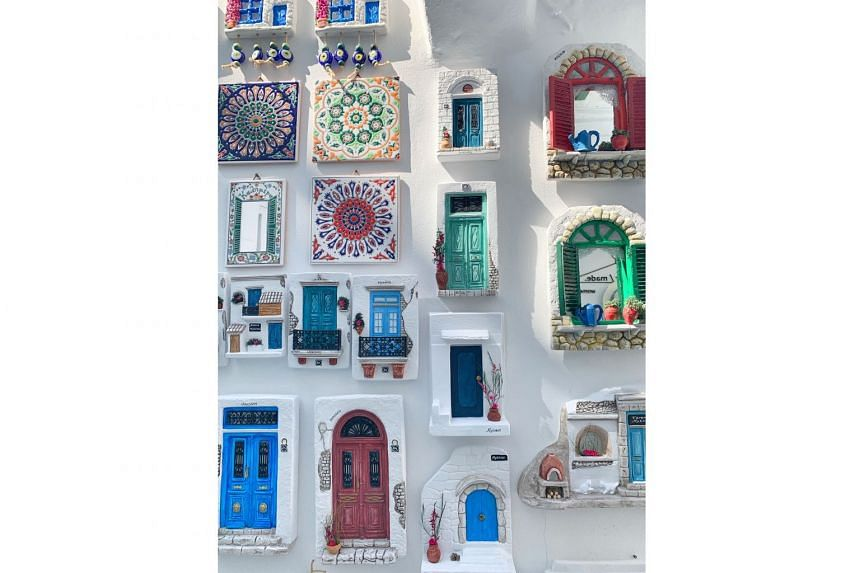 Souvenirs from Mykonos, which show doors in myriad colours other than the common blue.