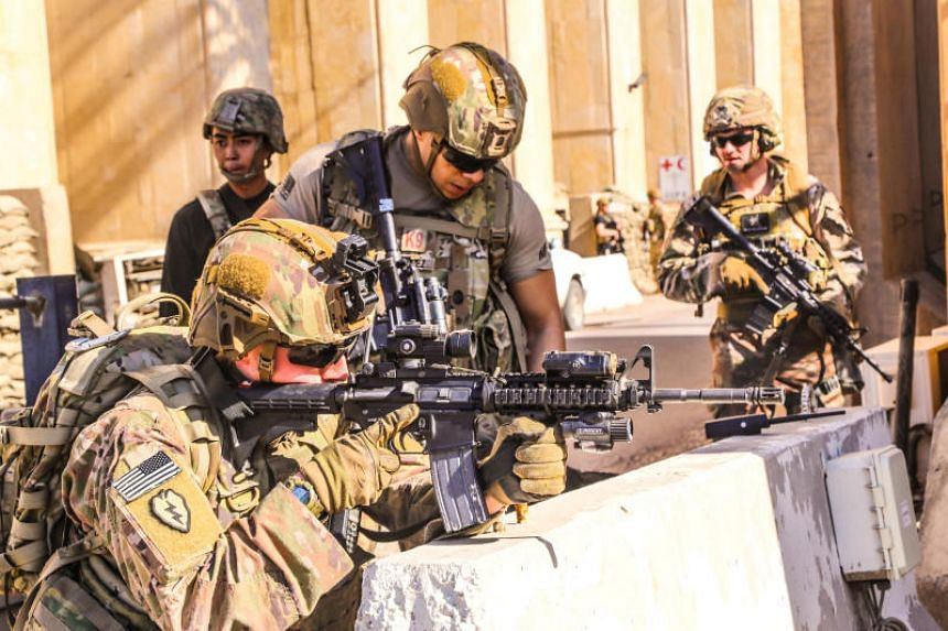 US Army soldiers from the 25th Infantry Division manning a defensive position at Forward Operating Base Union III in Baghdad on Dec 31, 2019.