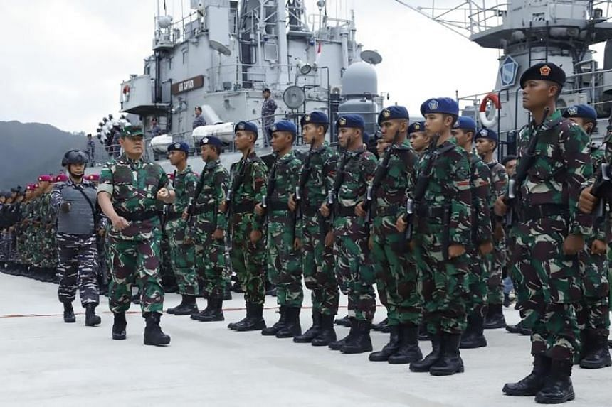 In this handout picture, Yudo Margono of the Indonesian military inspects troops at Natuna military base in the Riau islands on Jan 3, 2020.