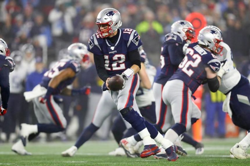 The loss against the Tennessee Titans resulted in the earliest postseason exit for Tom Brady (holding ball) and the New England Patriots in a decade.