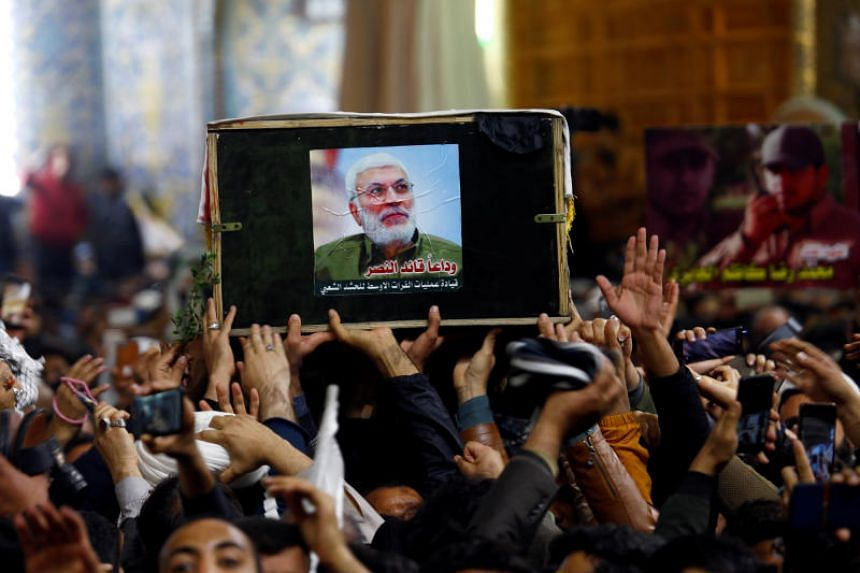 Mourners attend a funeral procession for the Iranian commander Qassem Soleimani at Imam Ali Shrine in Najaf, Iraq, on Jan 4, 2020.