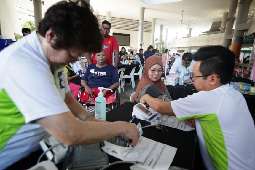 """Admiralty resident Kamisha Sumadi having her blood pressure taken at the """"Screen for a Screen"""" event at Kampong Admiralty Plaza on Jan 5, 2020."""