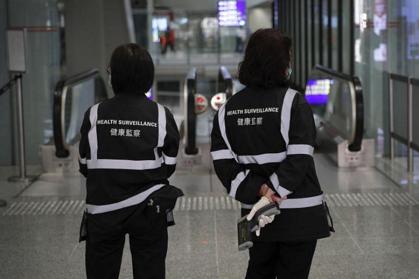 Health surveillance officers waiting to scan passengers at Hong Kong International Airport on Jan 4, 2020.