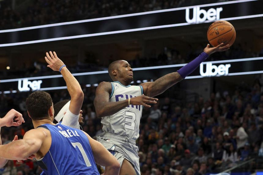 Charlotte Hornets guard Terry Rozier grabs the ball during an NBA basketball game against the Dallas Mavericks on Jan 4, 2020.
