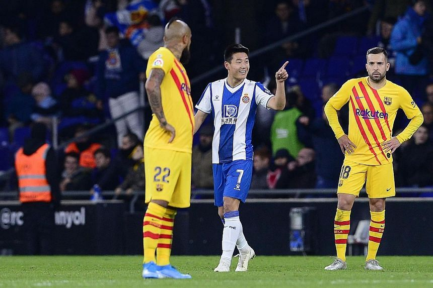 Espanyol's Chinese forward Wu Lei celebrating his 88th-minute equaliser in the home's side 2-2 draw against Barcelona. The result enabled Real Madrid to pull level with Barca at the top of the table, behind only on goal difference, after a 3-0 win at
