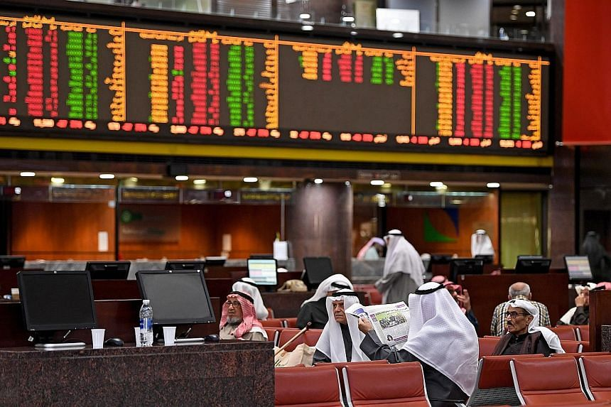 Traders observing stock market developments at the trading hall of the Kuwait Stock Exchange yesterday. The US air strike that killed Iranian commander Qassem Soleimani in Baghdad has injected new uncertainties into the market.