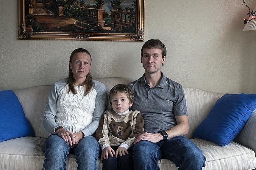 Whistle-blowers Vitaly and Yuliya Stepanov, 37 and 33 respectively, with their son, Robert, 6, at their home at an undisclosed location in the United States. They have moved at least six times since leaving Russia.