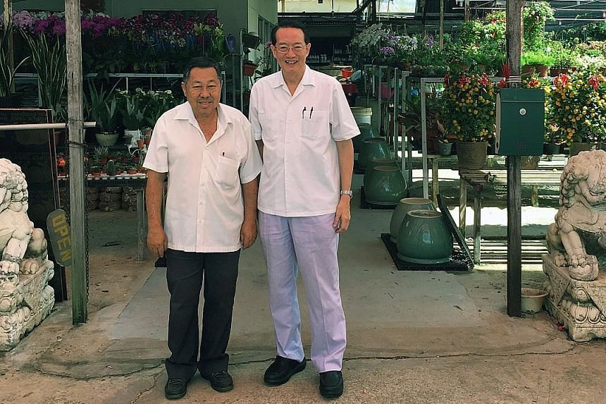 Woffles Wu (right) has been buying plants from Mr Larry Chua Soo Mong (left), 69, who owns Khai Seng Garden in Evans Road, since he was a teenager and the two have become good friends over the years.