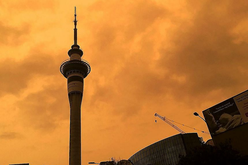 The sky above Auckland's Sky Tower turned orange yesterday as smoke from Australia's bush fires drifted over to New Zealand. The authorities received a flood of emergency calls from members of the public who were alarmed by the thick orange haze. PHO