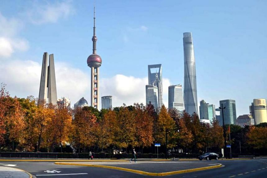 The skyline of Shanghai in December 2019. Results of a private survey suggest services companies in China remain cautious despite a flurry of stimulus measures, signs of improvement in the manufacturing sector and a long-awaited US-China trade deal.