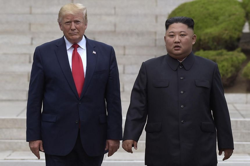 US President Donald Trump (left) meeting North Korean leader Kim Jong Un at the village of Panmunjom in the Demilitarized Zone in Korea, on June 30, 2019.