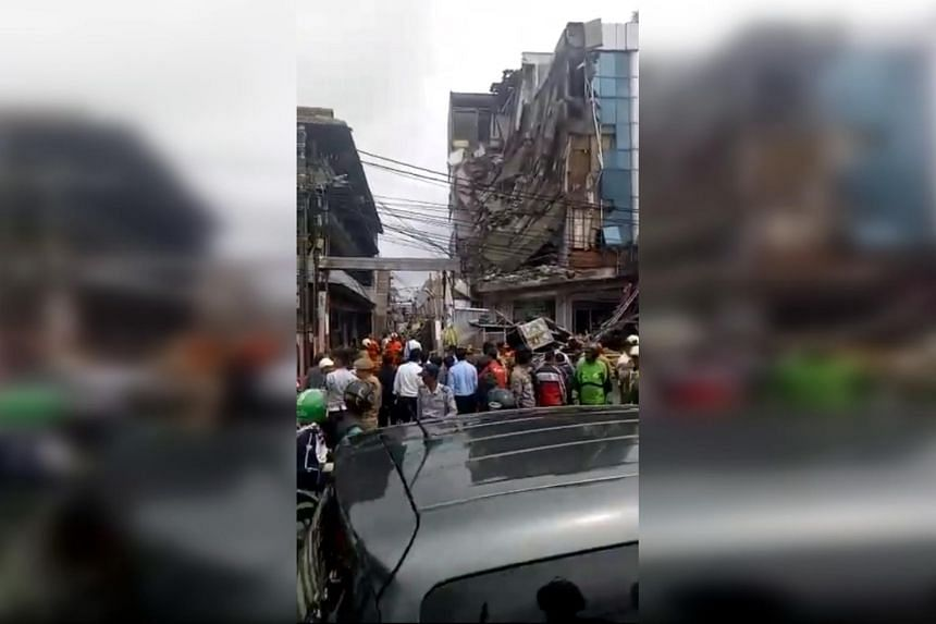 TV images showed about half the building, located on the massive city's western side, had caved in with concrete and other debris lying on the road.