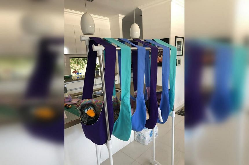 "Crafters have crocheted, knitted and sewed a range of items including pouches (pictured) for infant ""joey"" kangaroos who have lost their mothers and koala mittens for burned paws."
