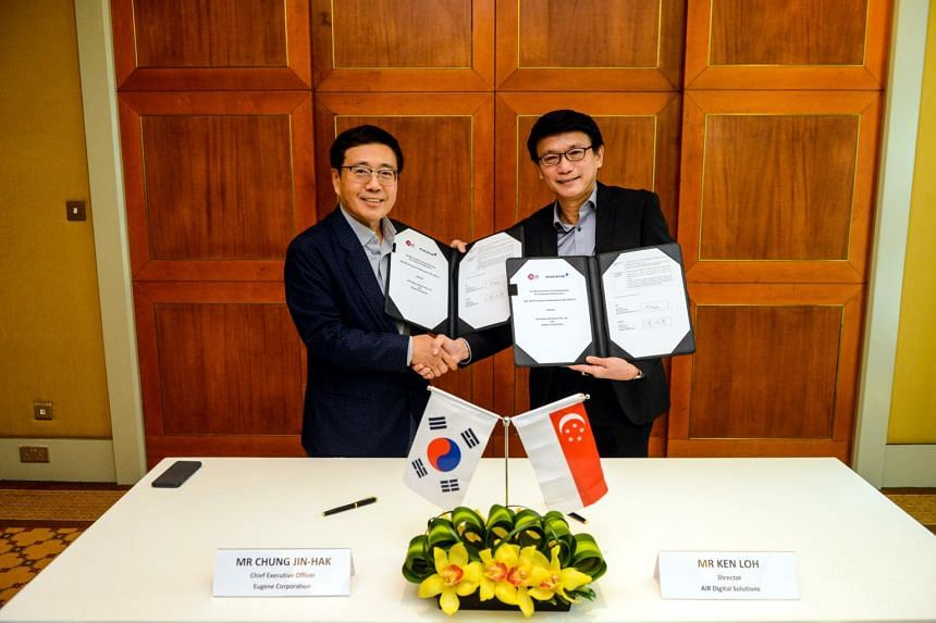 Mr Chung Jin-hak (left), CEO of Eugene Corporation, and Mr Ken Loh, Director of AiR Digital Solutions, shaking hands after the signing of a memorandum of understanding.