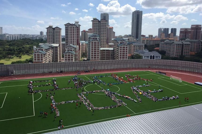 "Eunoia Junior College students forming the words ""EUNOIA HOME"" on the football pitch at their new Bishan campus on Jan 6, 2020."