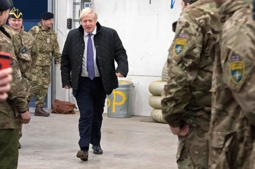 In a photo taken on Dec 21, 2019, British Prime Minister Boris Johnson walks out to speak with the Queen's Royal Hussars stationed in Estonia.
