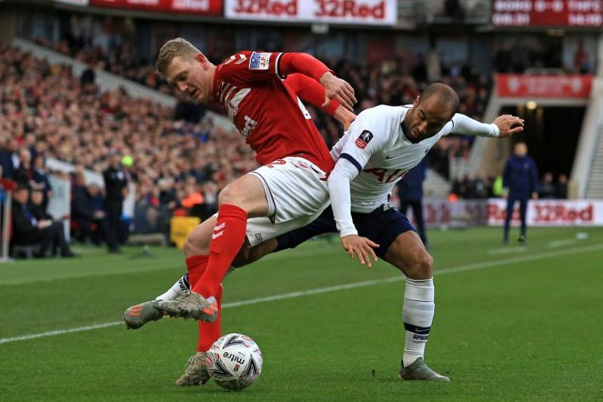 Middlesbrough midfielder George Saville (left) vies with Tottenham Hotspur's Lucas Moura during the English FA cup third round football match on Jan 5, 2020.